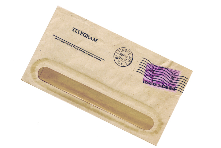 """""""Closeup of 1945 telegram with 3 cent U.S. stamp celebrating the centenary of the telegraph. You can see through the postmark the phrase, What hath God wrought"""""""